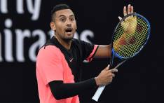 Australia's Nick Kyrgios speaks to the umpire during their men's singles second round match against Serbia's Viktor Troicki on day three of the Australian Open tennis tournament in Melbourne on 17 January 2018. Picture: AFP.