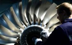 A Rolls-Royce engineer works on an engine. Picture: @RollsRoyce/Twitter