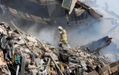 An Iranian firefighter walks amidst the debris of Iran's oldest high-rise, the 15-storey Plasco building in downtown Tehran on January 19, 2017. Picture: AFP
