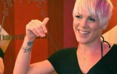 Singer Pink poses inside the door 6 female toilet block at the Brisbane Entertainment Centre. Picture: Getty Images.