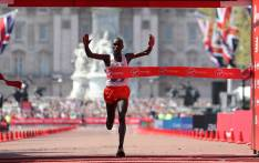 Kenya's Eliud Kipchoge crosses the finish line to win the elite men's race of the 2018 London Marathon in central London on 22 April 2018. 