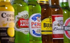 Bottles of beer and cider produced by Belgian-Brazilian group Anheuser-Busch InBev, (Budweiser, Corona, Stella and Becks) and British brewer SABMiller (Peroni and Bulmers). Picture: AFP.