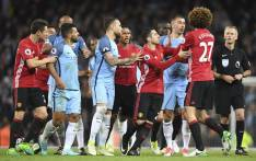 Manchester City and Manchester United players get involved in a shoving match during their English Premier League match. Picture: AFP
