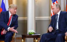 FILE: US President Donald Trump (L) and Russian President Vladimir Putin are pictured ahead of their meeting in Helsinki, on 16 July 2018. Picture: AFP.
