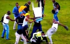 A screengrab of a security guard being attacked by Kaizer Chiefs fans following their defeat to Free State Stars in a Nedbank Cup match at the Moses Mabhida Stadium on 21 April 2018.
