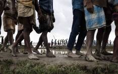 FILE: In September 2017, newly arrived Rohingya refugees from Myanmar walk through paddy fields and flooded land after they fled over the border into Cox's Bazar district, Chittagong Division in Bangladesh. Picture: Unicef