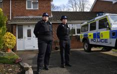 British police community support officers stand on duty outside a residential property in Salisbury, southern England, on 6 March 2018. Picture: AFP
