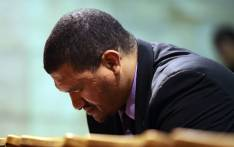 FILE: Western Cape ANC leader Marius Fransman bows his head during a prayer vigil at St Georges Cathedrral in Cape Town on 27 June 2013. Picture: AFP.