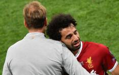 Liverpool's Egyptian forward Mohamed Salah (R) is comforted by Liverpool's German manager Jurgen Klopp as he leaves the pitch after injury during the UEFA Champions League final football match between Liverpool and Real Madrid at the Olympic Stadium in Kiev, Ukraine on 26 May, 2018. Picture: AFP.