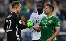 Germany's goalkeeper Marc-Andre Ter Stegen shakes hands with Mexico's forward Javier Hernandez (in green) after the 2017 Confederations Cup semi-final football match between Germany and Mexico at the Fisht Stadium in Sochi on 29 June, 2017. Pictured: AFP