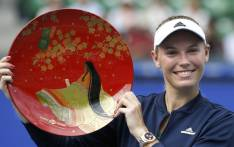 Caroline Wozniacki holds the winning plate after winning the final match against Anastasia Pavlyuchenkova at Pan Pacific Open Women's tennis tournament in Tokyo. Picture: @SI_Tennis/Twitter.