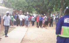 Foreigners staying in Pretoria West seen stranded following looting and vandalism of houses and shops. Picture: Kgothatso Mogale/EWN.