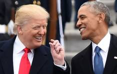US President Donald Trump and former President Barack Obama talk on the East steps of the US Capitol after inauguration ceremonies on January 20, 2017, in Washington, DC. Picture: AFP.