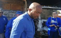 DA leader Mmusi Maimane outside the burnt Arts and Culture Department in Mahikeng. Picture: @Mabine_Seabe/Twitter.