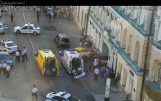 A handout CCTV picture released by the Moscow Municipal Traffic Regulation centre CODD, shows Russian police officers and paramedics working at the scene, after a taxi drove into a crowd injuring seven people on 16 June, 2018 in the centre of Moscow. Picture: AFP.
