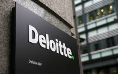 A Deloitte logo is pictured on a sign outside the company's offices in London on 25 September 2017.  Picture: AFP.