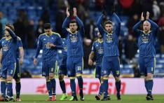 Celta Vigo players applaud their supporters at the end of the Spanish Copa del Rey. Picture: AFP.