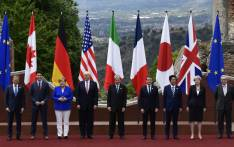 From left : President of the European Council Donald Tusk, Canadian Prime Minister Justin Trudeau, German Chancellor Angela Merkel, US President Donald Trump, Italian Prime Minister Paolo Gentiloni, French President Emmanuel Macron, Japanese Prime Minister Shinzo Abe, Britain's Prime Minister Theresa May and President of the European Commission Jean-Claude Juncker pose for a family photo during the Summit of the Heads of State and of Government of the G7 plus the European Union, on 26 May 2017 in Taormina, Sicily. Picture: AFP.