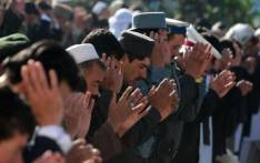 FILE: Afghan devotees pray during Eid al-Adha at the Shah-e Do Shamshira mosque in Kabul on 26 October 2012. The festival of sacrifice is celebrated throughout the Muslim world as a commemoration of Abraham's willingness to sacrifice his son for God, with cows, camels, goats and sheep are traditionally slaughtered on the holiest day. Munir uz Zaman/AFP