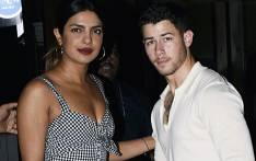 Indian Bollywood actress Priyanka Chopra (L) and US singer Nick Jonas (R) stand together in Mumbai on 22 June 2018. Picture: AFP.