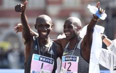 Kenya's Wilson Kipsang (L) and his compatriot Gideon Kipketer (R) celebrate after crossing the finish line in the men's category of the Tokyo Marathon in Tokyo on 26 February 2017. Picture: AFP