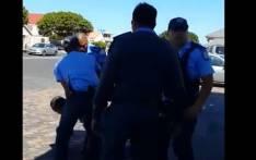 A screengrab of Cape Town traffic officials arresting a man.