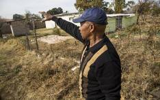 Willem Seboekoe gestures to a piece of land in Ennerdale, south of Johannesburg, which he claims belongs to his family that has been invaded by another family. Picture: Reinart Toerien/EWN