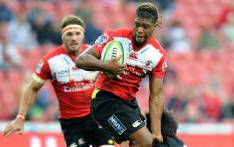 FILE: Howard Mnisi (L) of Lions is tackled by an opponent. Picture: AFP