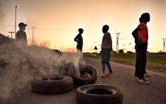 Demonstrators burn tyres in Mahikeng as they demand the removal of Premier Supra Mahumapelo on Thursday 18 April 2018. Picture: Ihsaan Haffejee/EWN