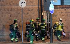 Medics deploy at the scene of a reported explosion during a concert in Manchester, England on 23 May, 2017. Picture: AFP.