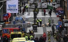 FILE: Emergency services work at the scene where a truck crashed into the Ahlens department store at Drottninggatan in central Stockholm on 7 April  2017. Picture: AFP.