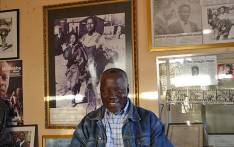 Former photojournalist Sam Nzima, with an image of the iconic Hector Pieterson picture he took in 1976, in his home studio in Bushbuckridge Mpumalanga. Picture: EWN.