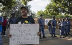 Police guard the Hoërskool Overvaal  in Vereeniging where EFF members are protesting the school's admission policy on 17 January 2018. Picture: Ihsaan Haffejee/EWN