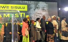 ANC supporters pictured near a poster of presidential hopeful Lindiwe Sisulu on 22 July 2017. Picture: Katleho Sekhotho/EWN.