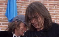 FILE: Australian guitarists and brothers Angus (L) and Malcolm Young of the hard rock group AC/DC inaugurate the first street in the world bearing their group's name in Leganes, 29kms from Madrid. Picture: AFP