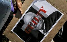 FILE: A woman holds a placard during a #HerNameIsFezeka march on 2 November 2016 in remembrance of Fezeka Ntsukela Kuzwayo, known as Khwezi, who accused President Jacob Zuma of rape in 2005. Picture: EWN