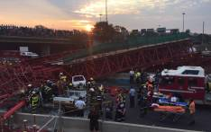 FILE: Paramedics and police at the scene of a collapsed scaffolding of a pedestrian bridge under construction in Sandton on 14 October 2015. The bridge was being built parallel to Grayston Drive over the M1. Picture: Christa Eybers/EWN