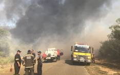 Firefighters battle a blaze in Fisherhaven and Hawston on Thursday 22 March 2018. Picture: Twitter/@OverbergFPA