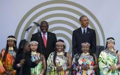 Former US President Barack Obama (right) and South African President Cyril Ramaphosa on stage behind the Soweto Gospel Choir, during the 2018 Nelson Mandela Annual Lecture at the Wanderers cricket stadium in Johannesburg on 17 July 2018. Picture: AFP.