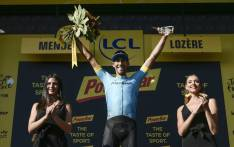 Spain's Omar Fraile celebrates on the podium after winning the 14th stage of the 105th edition of the Tour de France cycling race, between Saint-Paul-Trois-Chateaux and Mende on 21 July, 2018. Picture: AFP.
