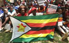 Zimbabweans gather as they call for Zimbabwean President Robert Mugabe to step down. Picture: Ihsaan Haffejee/EWN