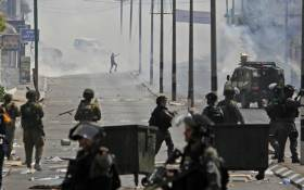 Tear gas fumes billow during clashes between Palestinian protesters and Israeli forces after Friday prayers at the main entrance of the West Bank city of Bethlehem on 21 July 2017. Picture: AFP