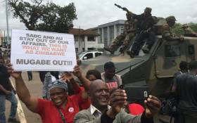 Zimbabweans take selfies with soldiers during a protest march against President Robert Mugabe on 18 November 2017. Picture: EWN
