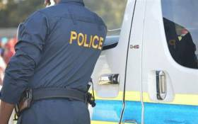 A police official on scene where the body of David Bellet-Brissaud was found at the Port Elizabeth harbour. Picture: SAPS/facebook.com