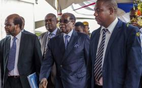 FILE: Zimbabwe's former President Robert Mugabe (centre) arrives for a graduation ceremony at the Zimbabwe Open University in Harare on 17 November 2017. This is his first public appearance since a military takeover on 14 November 2017. Picture: AFP