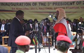 Emmerson Mnangagwa is sworn in as Zimbabwe's new president in Harare on 24 November 2017. Picture: AFP.
