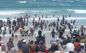 Bathers hit the surf at Mnandi Beach. Picture: Supplied.