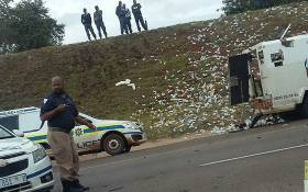 Cash littered the ground following  a heist on the N4 in Pretoria on 23 February 2018. Picture: @LuckyEvansCeo/twitter.com