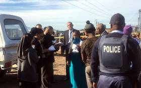 Officials are pictured on scene where an inspection was conducted in Khayelitsha where the body of Sinoxolo Mafevuka was found. Picture: Kevin Brandt/EWN.