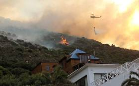 A chopper belonging to Working on Fire was deployed to Glencairn on the weekend of the 22 November 2014. Picture: @wo_fire via Twitter.